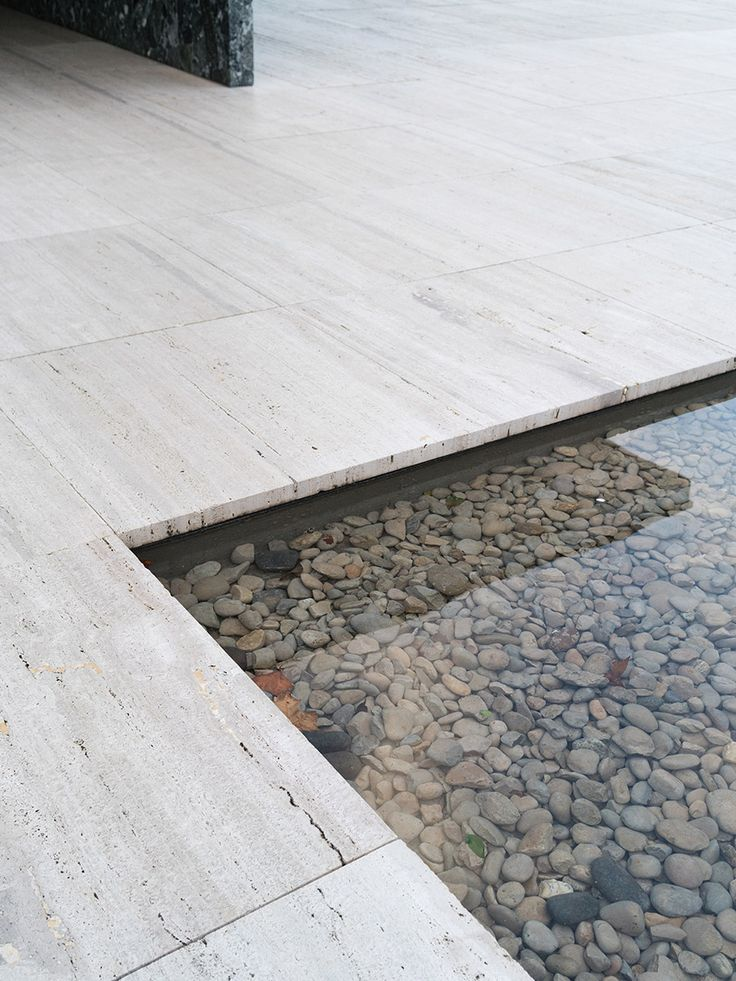 stone and pebble | reflective pool || Barcelona Pavilion by Mies van der Rohe. Shot by Alice Gabo for Cereal Magazine.
