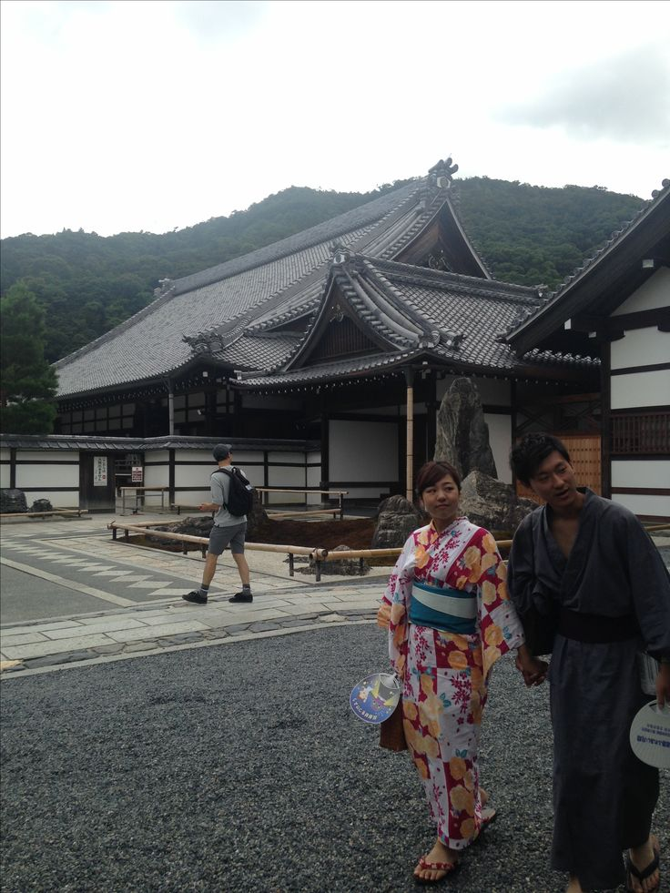 Temple with appropriately dressed passersby in Kyoto, Japan