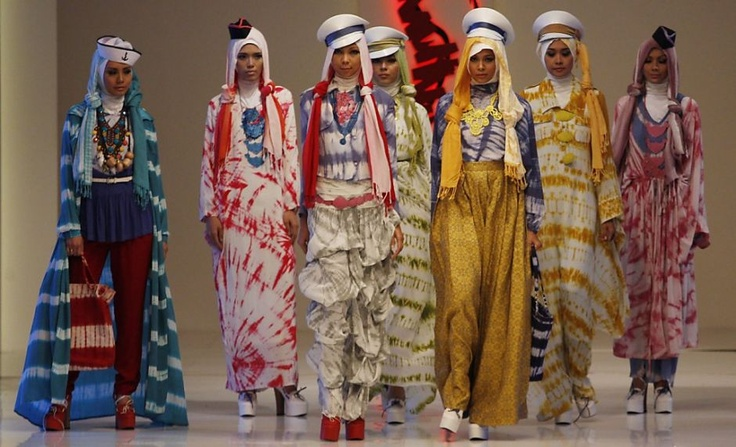 Models present  creations in an Indonesian fashion show.