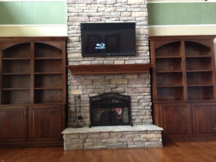 Bookshelves Around Stone Fireplace Fireplaces