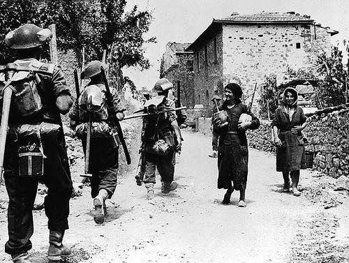 Canadian Troops enter a village where a week earlier German soldiers had massacred the entire Male population. San Pancrazio, Italy, July 16, 1944.