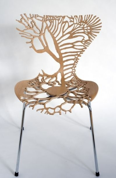 carved chair Artist Lisa Jones created a series called Symbiosis that took inspiration from parts of the human body. Though I think this chair looks more lung-like in shape, it was actually inspired by a part of the digestive system.