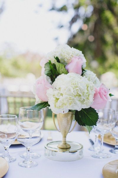 #roses #hydrangeas #centerpiece Photography by jasmine-star.com/ Read more - http://www.stylemepretty.com/2013/07/29/mccormick-home-ranch-wedding-from-jasmine-star-photography/