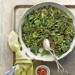 Greens can be cooked in minutes over high heat, making it possible to serve collards on a busy weeknight. Try this recipe with whatever green you've got on hand, or mix a few varieties together.