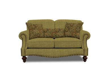 Transitional styling! Ultimate style and comfortable seating are yours in this transitional style chair. Features a high back with a semi attached back Cushion over a box end Cushion arm accented with small nail head trim, front rail accented with larger nail head trim, all help turn this classic transitional style into a work of art.