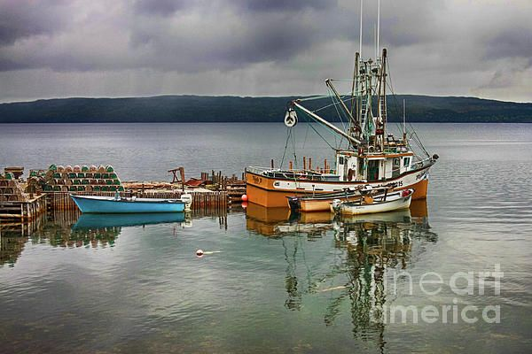 Fishing boats in a cloudy rainy day in Gros Morne National Park, Newfoundland, Atlantic Canada