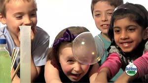 Unique Science Party - Grabbing a bubble!