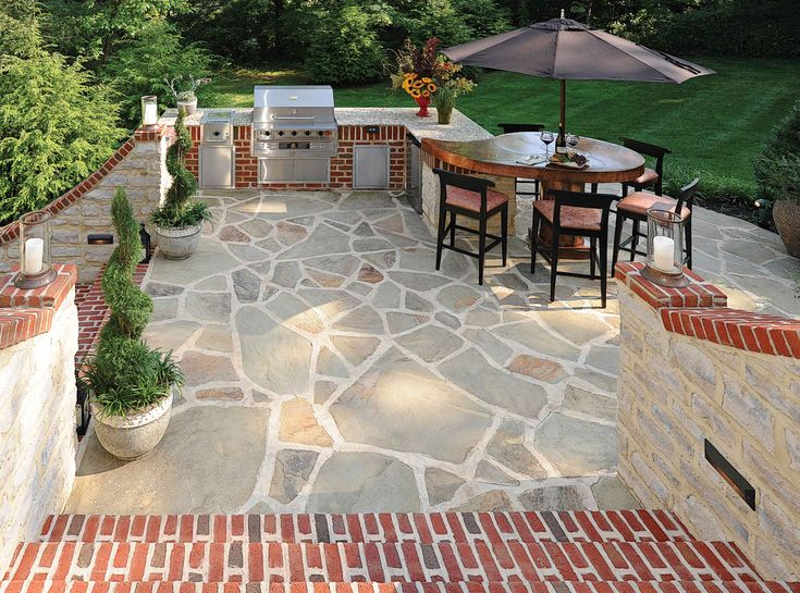 Red brick with gray mortar provides a nice visual punch to for Red brick patio ideas