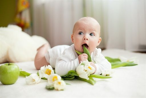 Baby with tulip flowers