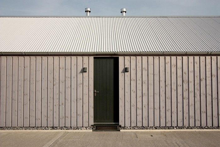 Rural Office for Architecture, New Barn, exterior gray siding, corrugated metal roof, Wales   Remodelista