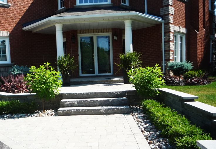 Front entrance design,precast pavers walkway, natural stone steps,walls and gardens.