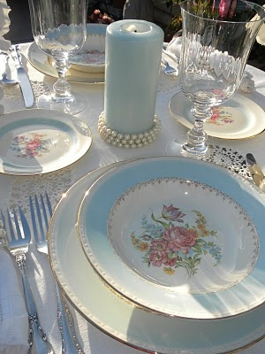 Touch of romance tablescape...love the pearls around the base of the candle.