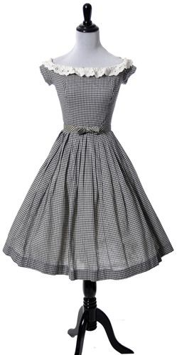 Gingham Vintage dress Vintage Farm girl chic! Black and white gingham vintage dress from the 1960s with white eyelet lace trim and original bow belt that snaps into place. Dress has softly pleated ski