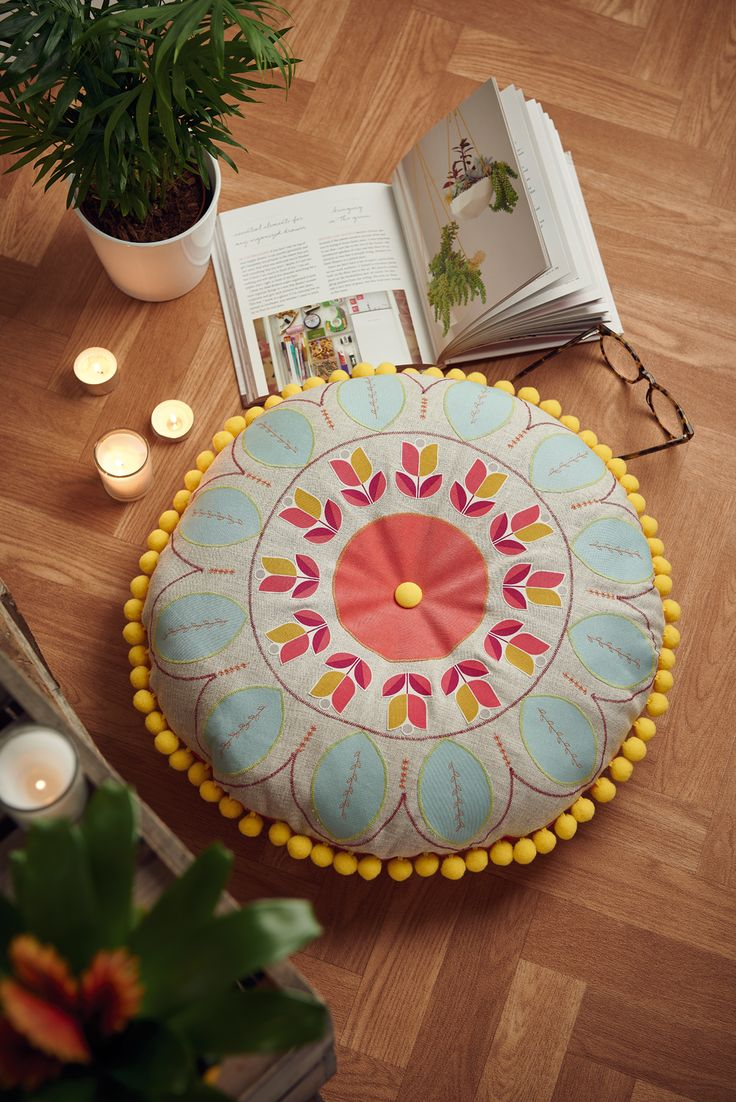 Learn how to make this appliqued and embroidered AND pompom-ed floor cushion in issue 45 of Homemaker // Image: cliqq.co.uk