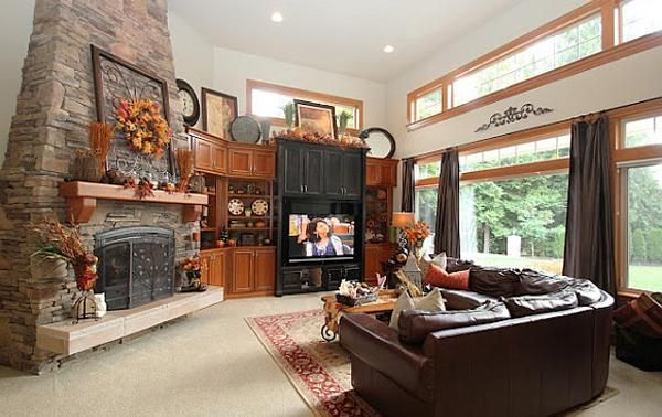 Living Room. Comfortable Thanksgiving Living Room Decoration Improvement Autumn Design Ideas : Fancy Fall In Ideas Thanksgiving Decoration Living Room Design With Permadani Also Stone Decorative Fireplace And Brown Leather Sofa In The Living Room Corner ~ wegli