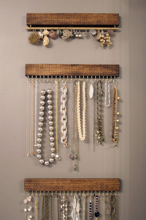 three wood and brass display racks: two for necklaces and bracelets, one for earrings (wall hanging)