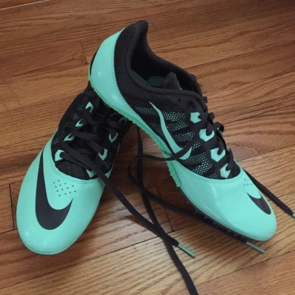 Nike Track & Field Spikes Sprinter spikes , never been used , does not include tags, includes spikes , and spike bag Nike Shoes Athletic Shoes