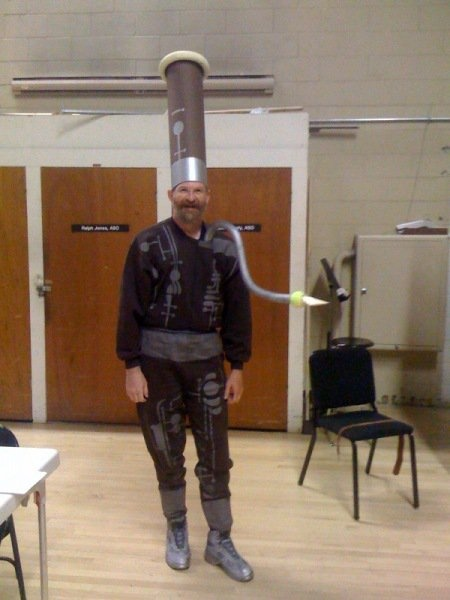 If you know what this costume is, you have my vote! <<~~ WHAT THE CRAP?! ITS A FREAKING BASSOON COSTUME. Oh I am so showing this to my friend who plays bassoon....... XD