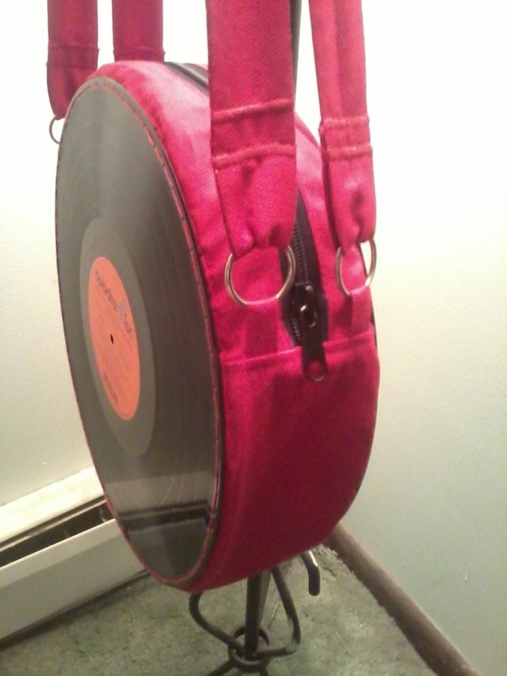 Awesome, eye-catching, unique. Just like you. . Free tutorial with pictures on how to make a vinyl record purse in 34 steps by needleworking, sewing, and melting with zipper, sewing machine, and vinyl record. Inspired by gifts, music & bands, and geeky. How To posted by Khayotikk. in the Home + DIY section Difficulty: 4/5. Cost: Absolutley free.