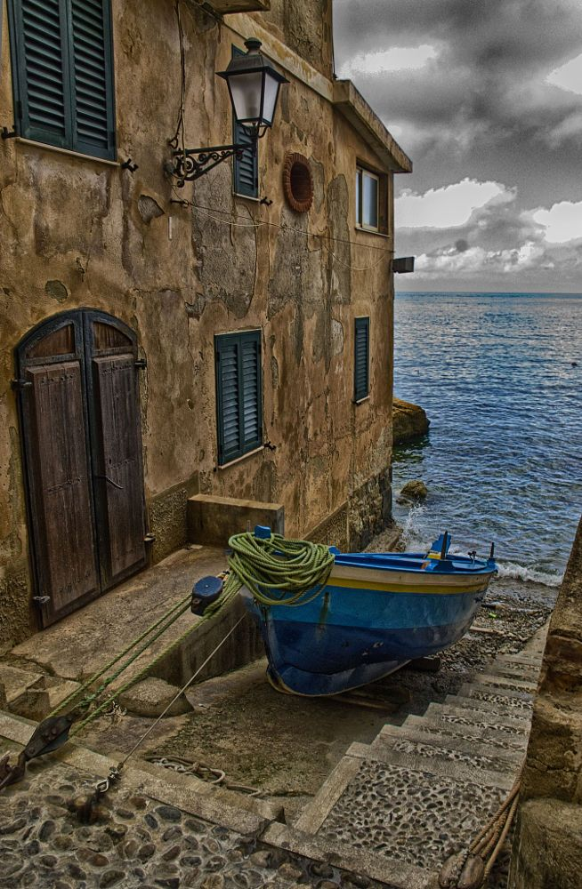 MOOD // Chianalea, Scilla, Italy -- by Marcello Mento / Colour pop on boat against muted backdrop