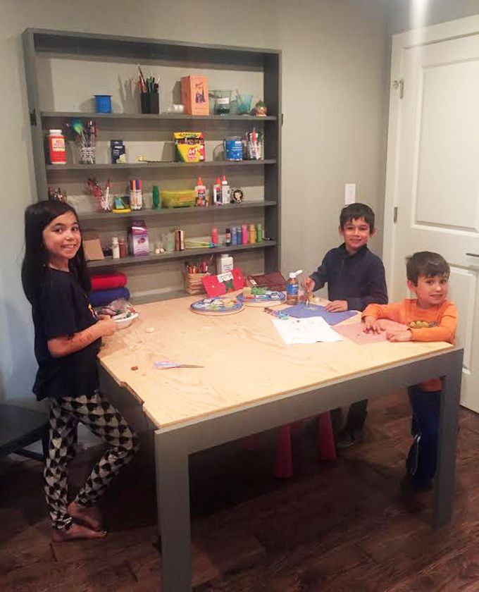 DIY STEM Table - folds up to hide shelves and provide more floor space.