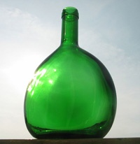 The Bocksbeutel (the bottle) is the traditional, legally-protected  [by the European Union] bottle shape for quality Franken wines.    The Bocksbeutel* was first used by the city of Würzburg in 1718 for an outstanding vintage, but it has been in existence much longer... flat spherical Celtic bottles made from earthenware, and dating from 1400 B.C. have been found near Aschaffenburg, Germany…