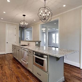 Long Gray Beadboard Kitchen Island With Stacked Dishwasher