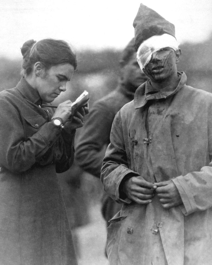 Salvation Army worker writing for wounded soldier.  France, 1918.