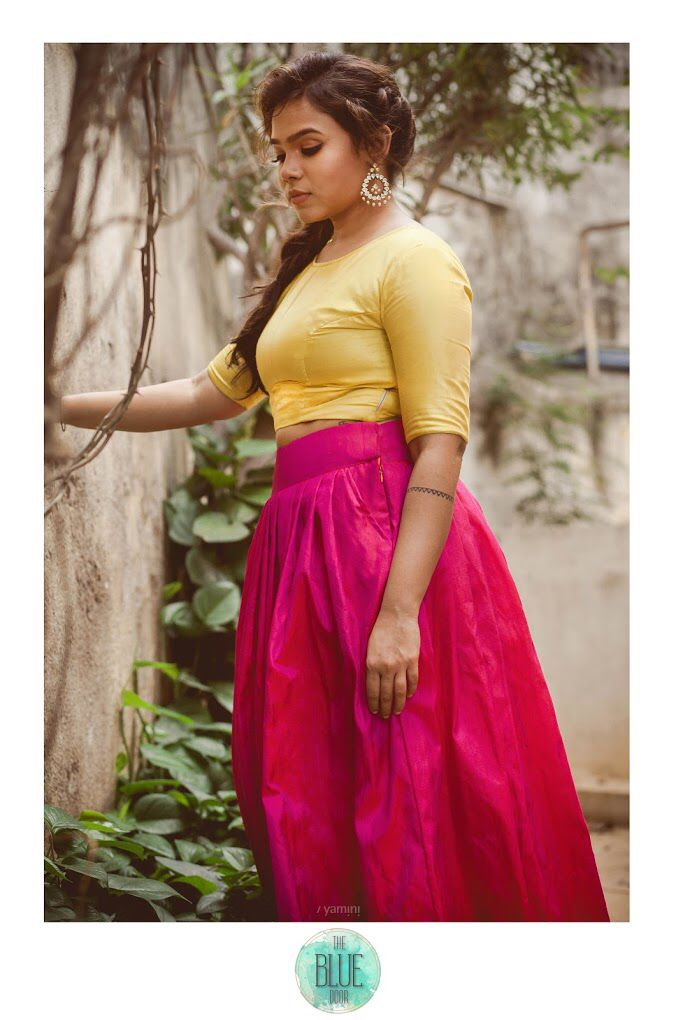 Green crop top with a pink-red raw silk skirt. For details,contact- bluedoor.the@gmail.com