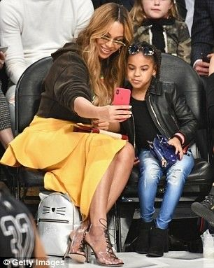 Mrs. Beyonce Knowles Carter and her daughter Blue Ivy