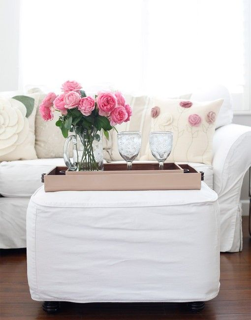 A large blush tray makes the perfect topper for an ottoman {The Little Market}