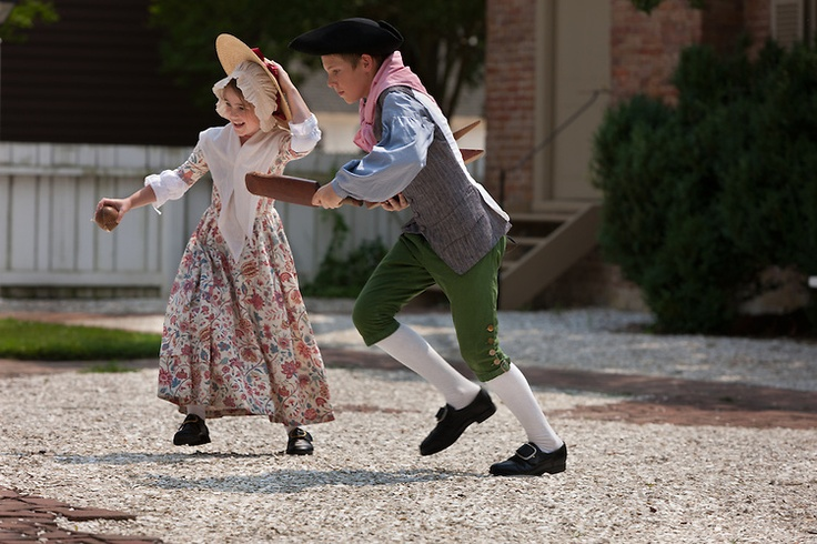 Kids playing trap ball in Colonial Williamsburg's Historic Area, Williamsburg, Virginia. Photo by David M. Doody