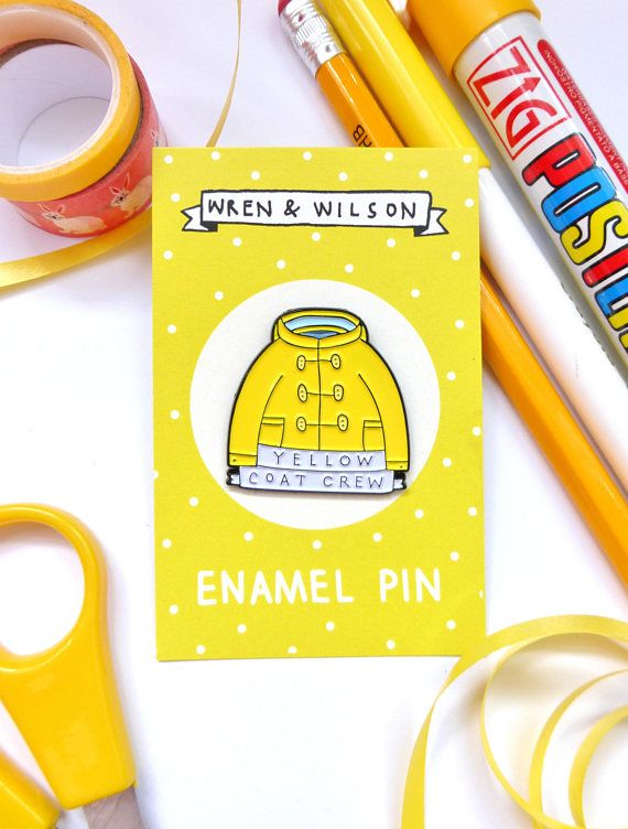 Enamel Pin Yellow Coat Crew. Colourful lapel pin badge for