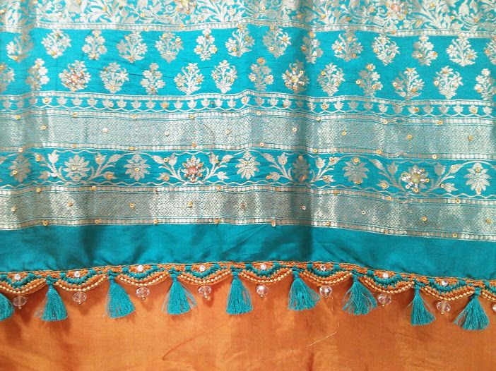 Kroshia work in blue and mustard enriched the silk saree pallu