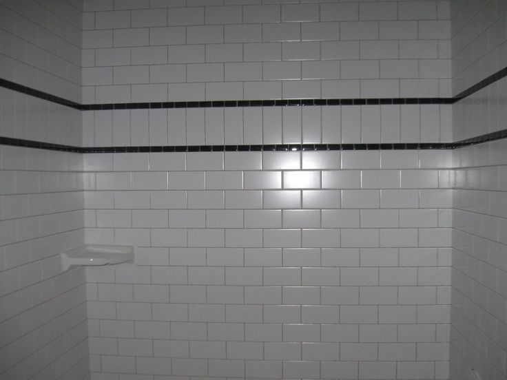White subway tile with black accent tile band (subway tiles run vertical within accent band)