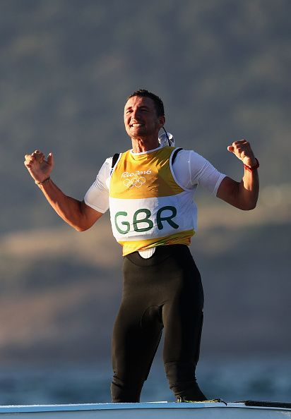 Giles Scott of Great Britain reacts after sealing the gold medal in the Finn…