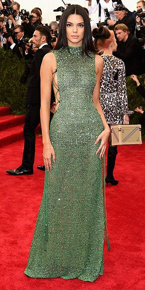 The Most Jaw-Dropping Dresses at the 2015 Met Gala | KENDALL JENNER | in custom jade-green side-laced Calvin Klein Collection and Chopard High Jewelry diamond drop earrings.