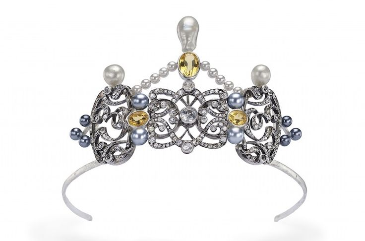 A tiara designed, by Ansuini High Jewelry, for the marriage of an Italian princess with an English nobleman, celebrated last year, it's Handmade in white gold 18 K and sterling silver, with old fashioned cut diamonds, baroque australian pearls and citrines, the tiara can be divided into three parts: in the center there is the ornament that can be detached and worn as a necklace or as a simple pendant, on both sides there are two pins