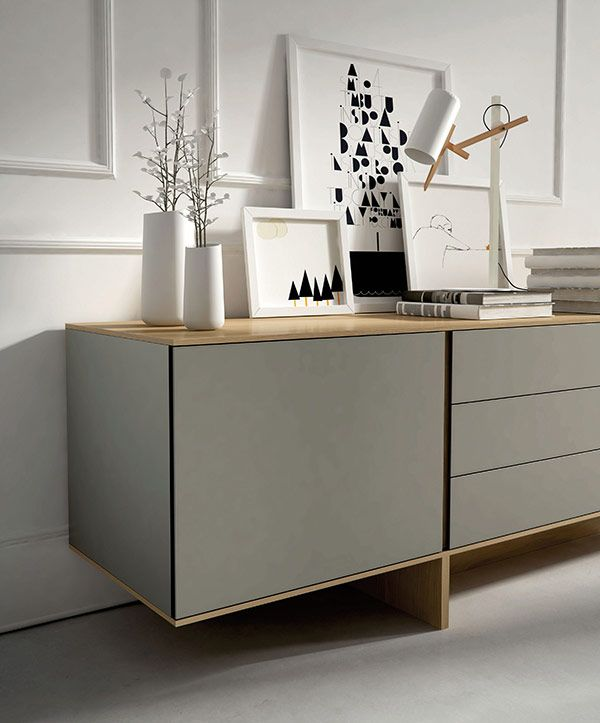 Simple yet wonderfully effective. Taupe sideboard with minimal white accessories against white panelled wall. Cool, contemporary and utterly charming.