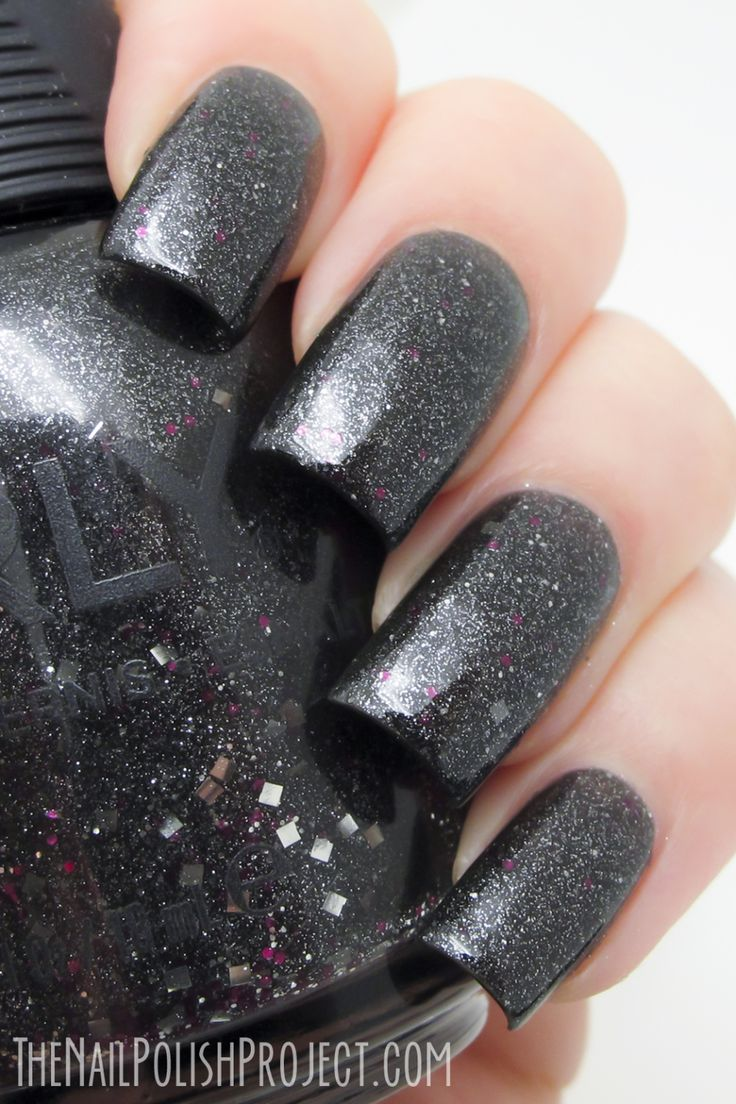 Masked ceremony is a charcoal grey jelly polish loaded with fine silver flakes to give a textured appearance