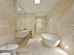 ... travertine looks wonderful. Add a slightly darker shade for a more  exquisite border and achieve a one of a kind contemporary looking stylish  bathroom.