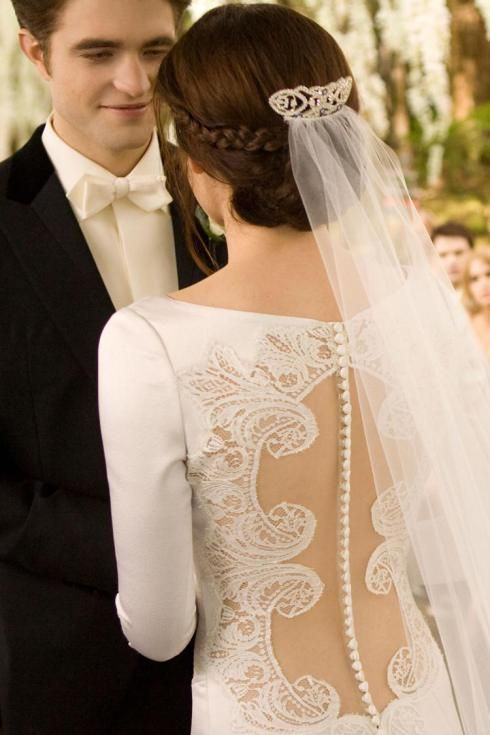 """Bella's wedding dress details #BreakingDawn 2."" Corny,I know. Still makes the fierce board."