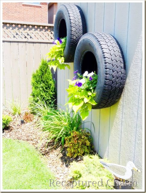 Using old tyres as wall planters can look very effective with trailing plants. | #gardening