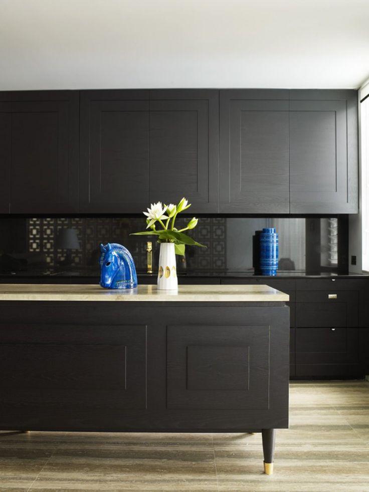 Greg Natale black kitchen design - see black splash back tiles add texture to the space.