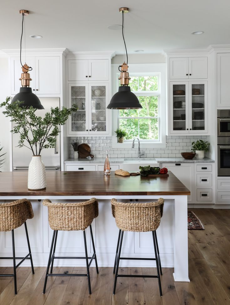 Modern country kitchen, white kitchen island, bar stools made of rattan, country bar
