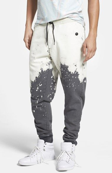 Free shipping and returns on True Religion Brand Jeans 'Jogknit' Slim Sweatpants at Nordstrom.com. For a look that could be defined as two-tone color-blocking for the distressed age, drawstring joggers in a rich charcoal knit are splattered with white above the knees. The style is designed for a slouchy look at the hips before gradually slimming toward the rib-knit cuffs.