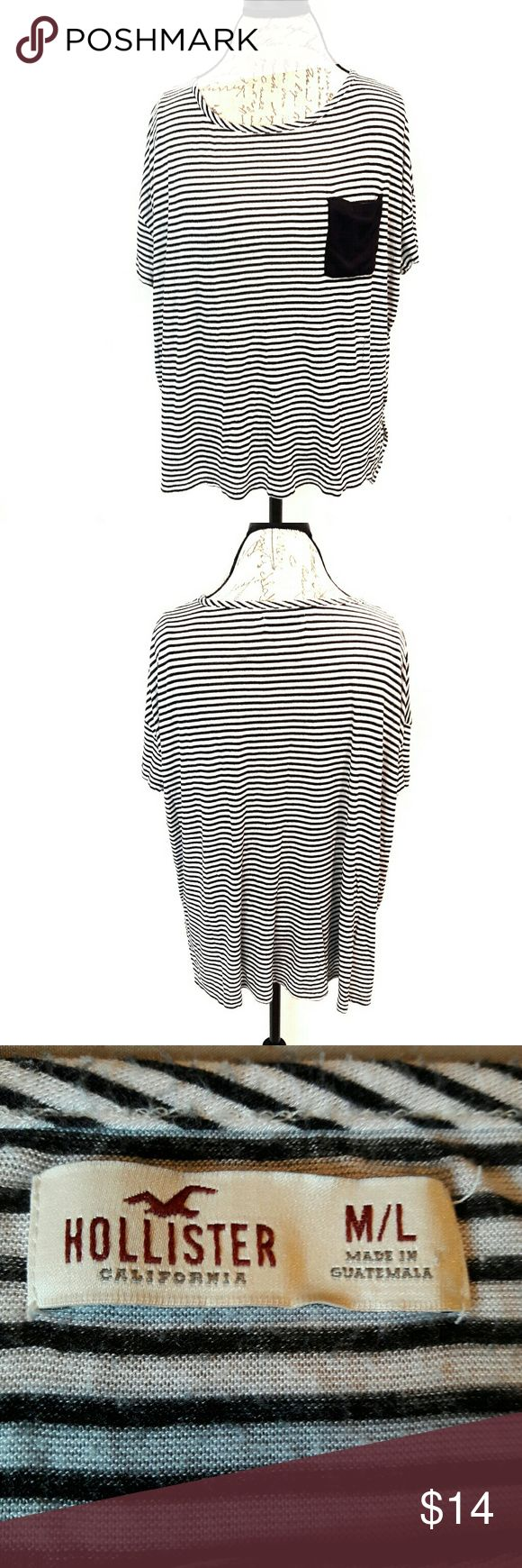 hollister ⏺ slouchy top In great condition! Very cute and comfortable hi low striped top. Has pocket on the chest. Black and white stripes. No material tag. Very soft material. Bust and length Measurements provided in pics above. This fit a medium or a large. Very roomy. From a smoke and pet free home. Fast shipping! Office - Vacation - Wedding - Fun - Dress up - date night - cruise - spring - summer *IF YOU LIKE MY ITEMS, please FOLLOW ME to see NEW ARRIVALS that are added weekly…