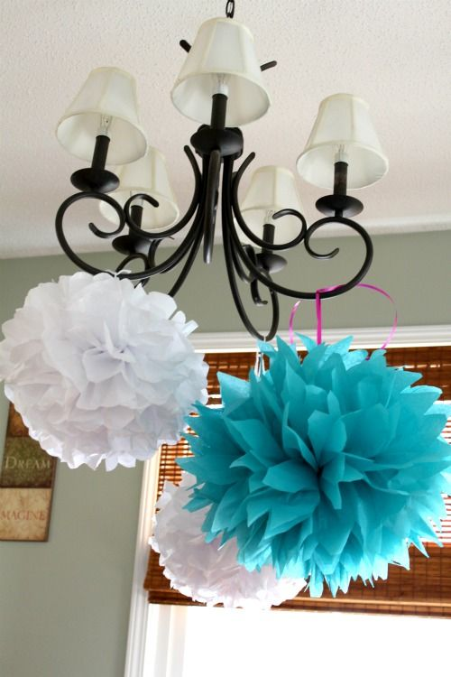 Beautiful and easy decor ideas for a party. Fold 8 sheets of tissue paper in an accordian. Trim the ends. Fold the paper in halt and tie a ribbon to hold it together. Pull the layers away all the way around and you are done!!!