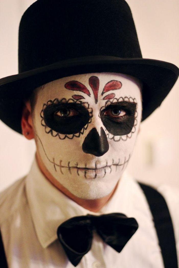 maquillaje halloween hombre, hombre maquillado como calavera mexicana con traje y gorro