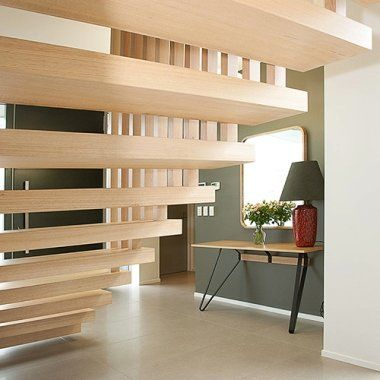 Floating steel stairs in Victorian Ash with timber slat balustrade
